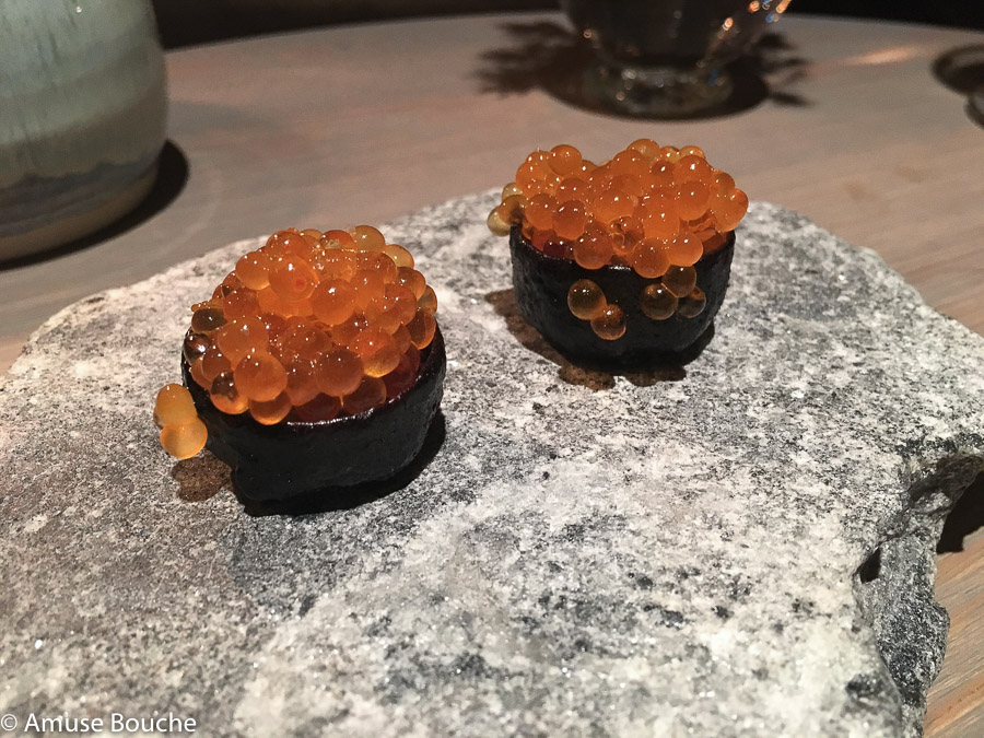 Wild trout roe served in a crust of dried pig's blood at Faviken